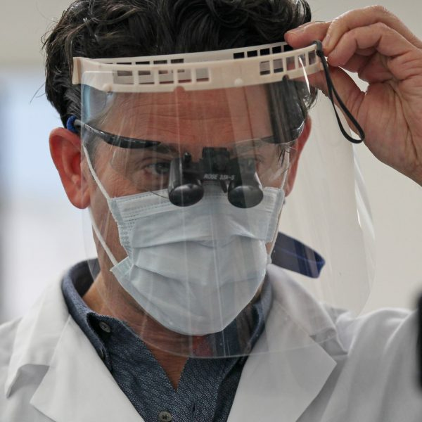 Michigan doctors and dentists sidelined by coronavirus crisis are back in business, with a new normal